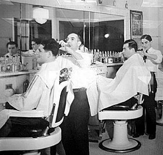 Vintage barbershop men getting hair cut.