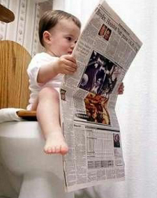baby on toilet reading newspaper