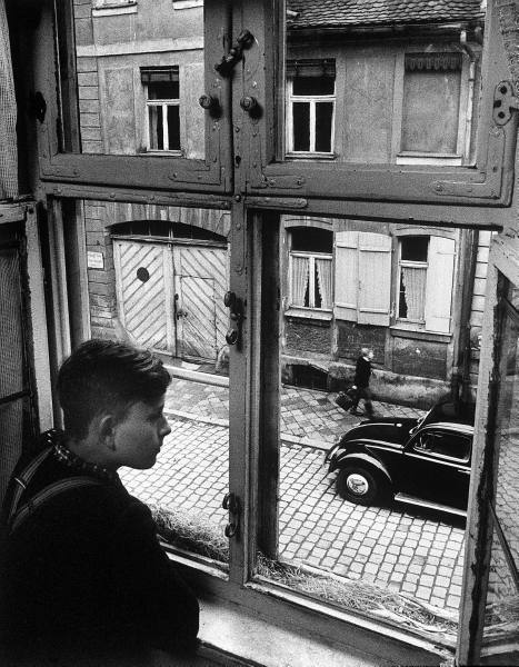 vintage boy looking out window 1930s 1940s