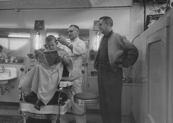 vintage father and son in barbershop 1940s 1950s
