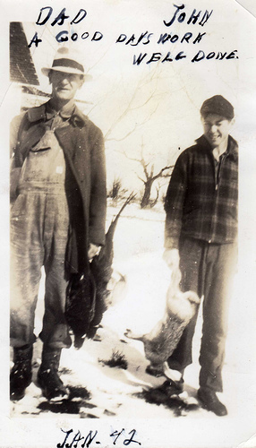 vintage father son hunting posing with catch