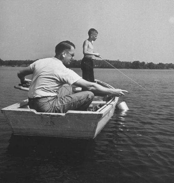 vintage father son fishing boat on lake 1950s
