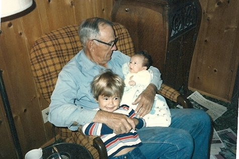 grandpa with small grandchildren in chair 1970s