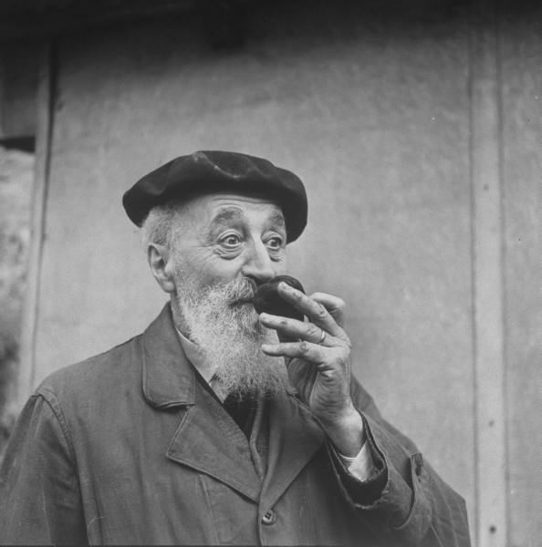 vintage old elderly man smelling fruit