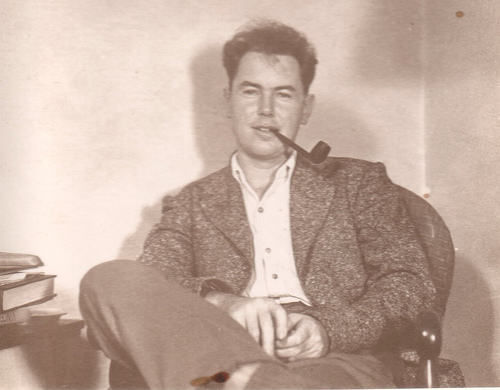 vintage man smoking pipe in chair