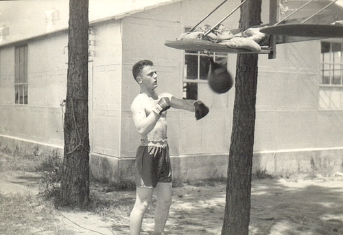 Vintage boxer practicing the speed ball bag.
