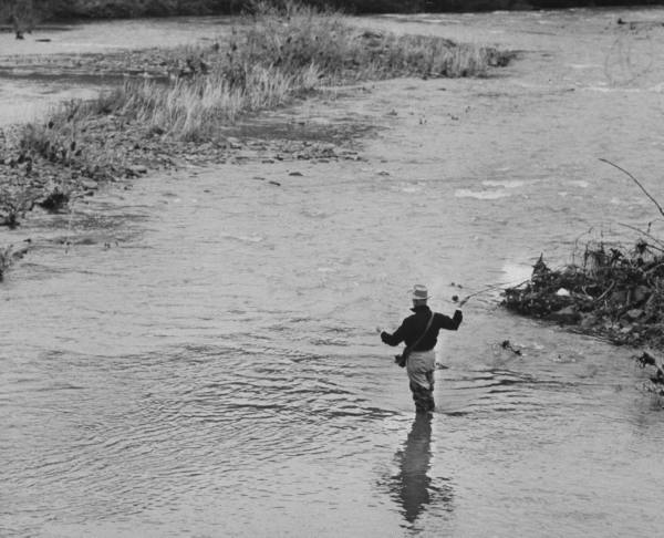 vintage fly fishing man standing in river