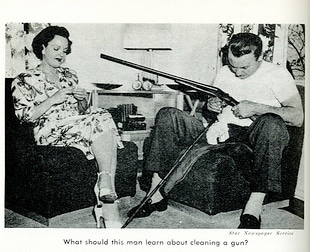 Vintage man cleaning gun and women sitting next to him.