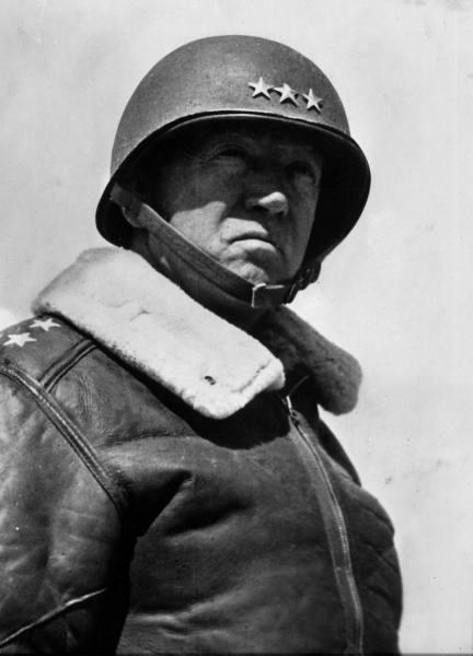 General georges patton bomber wearing coat and helmet.