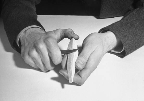 vintage man whittling hands pocket knife