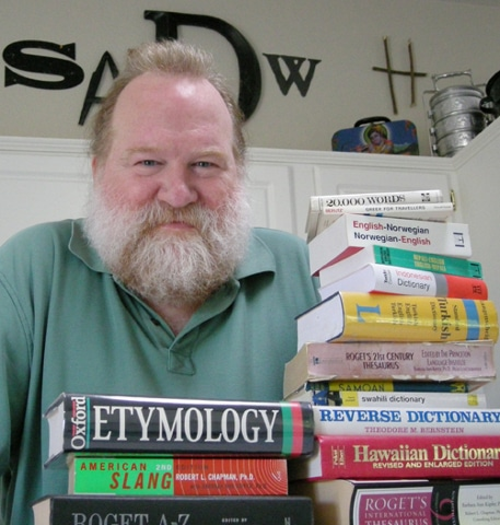 Mark Gunnion posing with his book's collection.