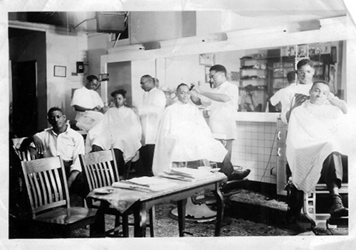 vintage african-american barbershop choosing a barber