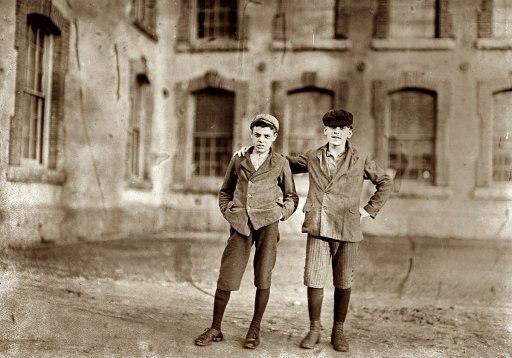 vintage boys standing in courtyard late 1800s