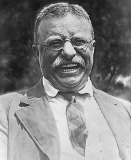 Theodore Roosevelt's laughing portrait showing mustache.