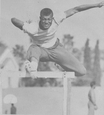 vintage african american man jumping over hurdle