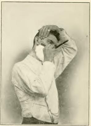 Vintage man shaving his beard.