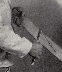 Illustration of stropping the razor honing blade in upward direction.