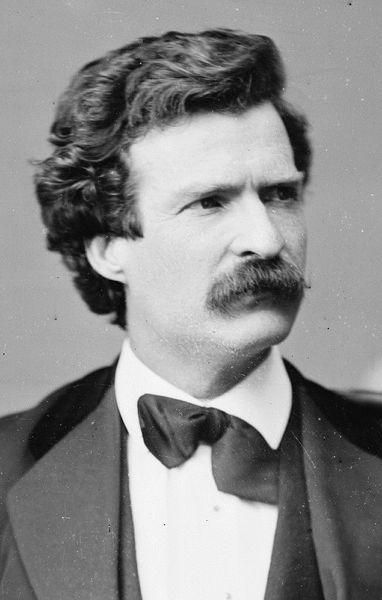 Mark Twain's portrait showing mustache in tuxedo.