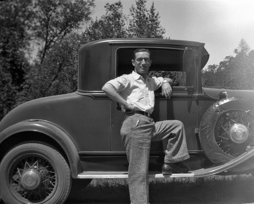 vintage man in front of car 1920s