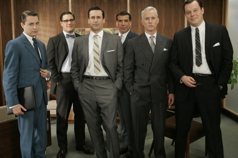 Mad men's cast standing for a picture.