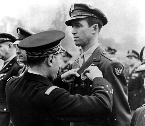 Jimmy Stewart getting medal pinned on ceremony.