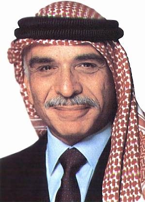 Hussein bin Talal smiling with mustache.