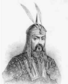 Genghis Khan in his suit posing showing mustache.