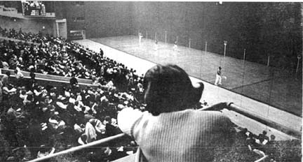 Vintage Jai alai's female spectator watching game from stands.