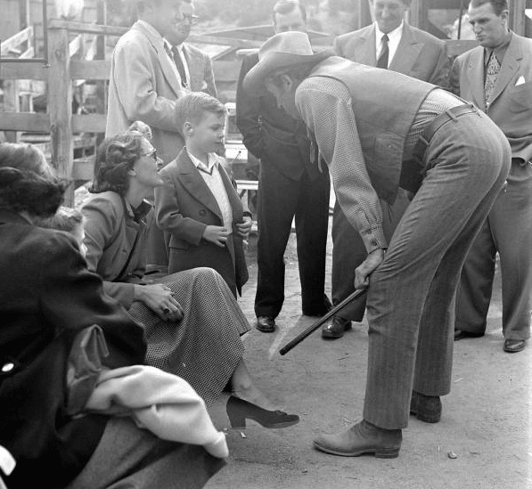 jimmy stewart as cowboy talking with young boy