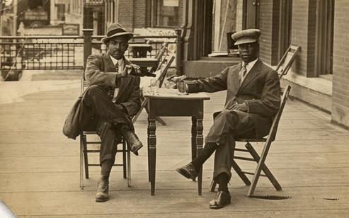 Vintage portrait of african formal men while sitting.