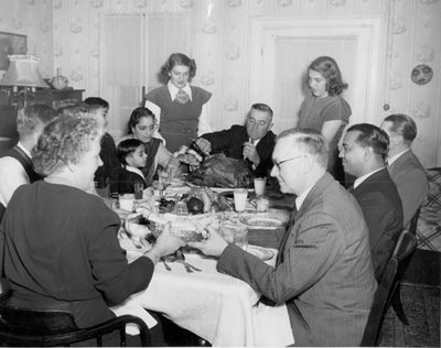 vintage family eating thanksgiving dinner carving turkey
