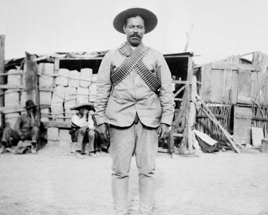 Pancho Villa's portrait showing mustache in field.