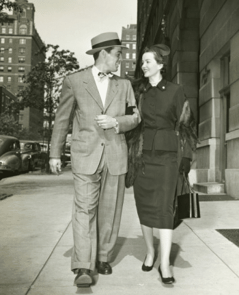 1940s couple walking down street date suit dress