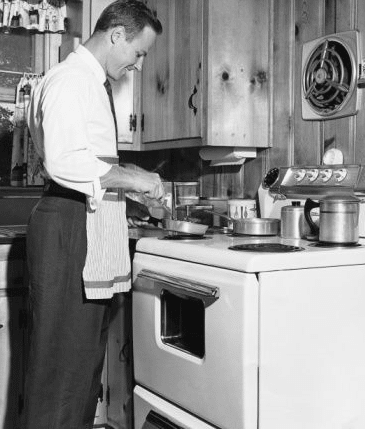 vintage man cooking at stove mid 1900s