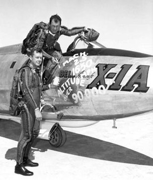 Vintage Chuck Yeager getting into airplane with co pilot.