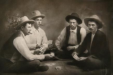 Vintage men playing cards while smoking.