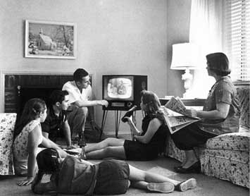 vintage 1950s family watching tv living room