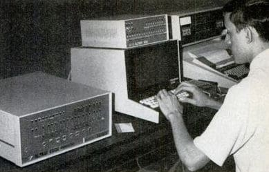 Vintage man using old computer first computing machines.