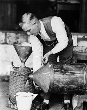 Vintage bootlegger homebrewing alcohol 1920s.