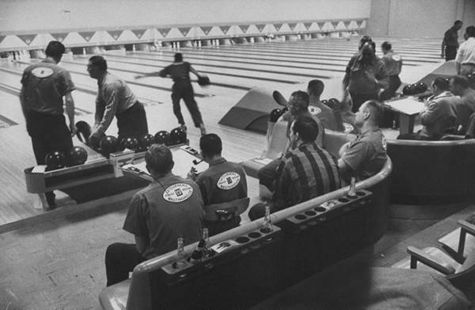 Vintage 1950s bowling alley league play.