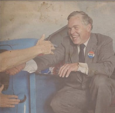 vintage politician campaigning shaking hands with people