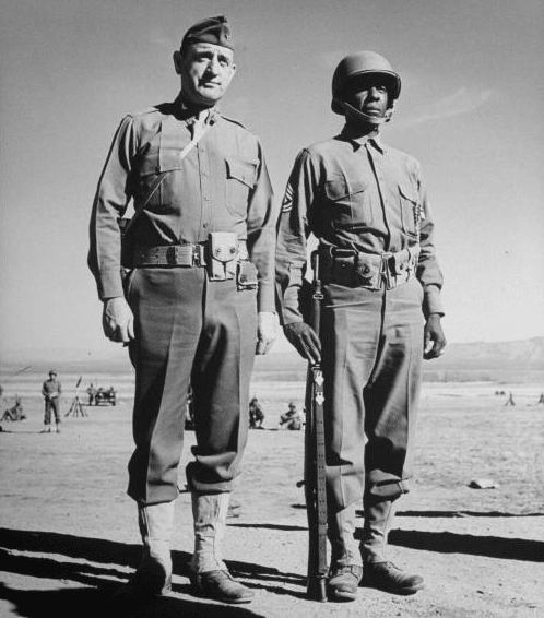 vintage soldiers in uniform standing in dessert