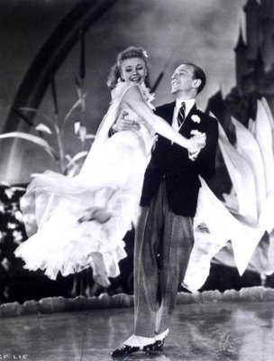 Ginger Rogers and Fred Astaire performing stage dance.