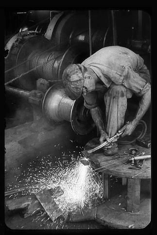vintage steelworker blue collar man in factory