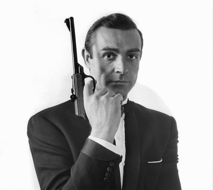 James Bond holding a gun.