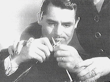 Vintage cary grant knitting manly hobbies.