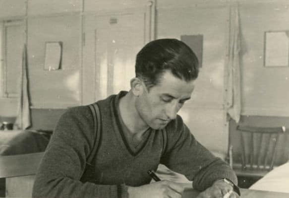 vintage man writing letter at desk pen paper