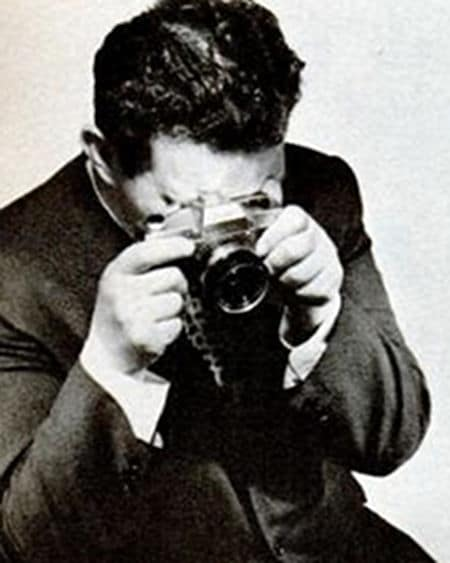 Vintage man taking photo by camera.