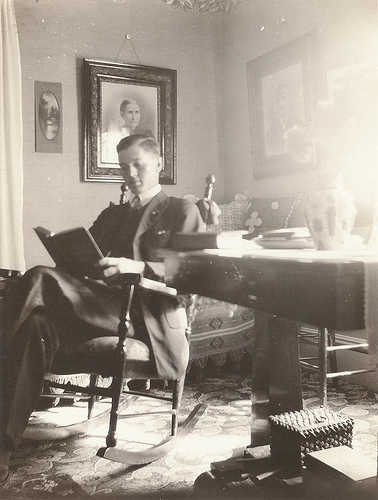 vintage man reading in chair late 1800s early 1900s