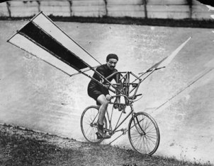 vintage man attempting flying bike wings